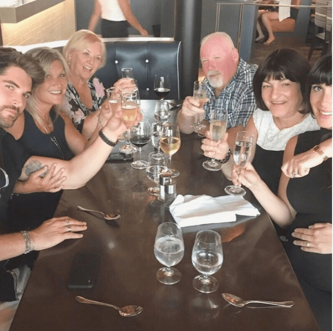 Nick with his then Fiancé Maria and their family, celebrating their engagement