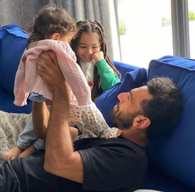 Salah Ghaly's son, Mohamed Salah, with two granddaughters.