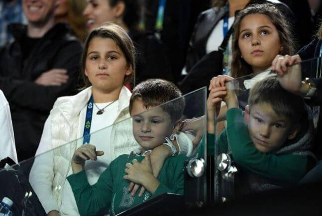 Leo Federer with his twin sisters and brother.
