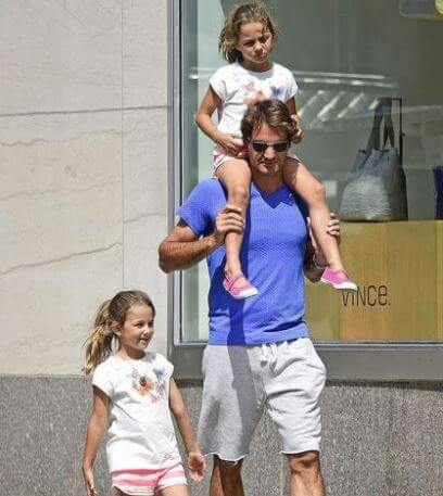 Charlene Riva Federer with her father, Roger Federer, and sister.