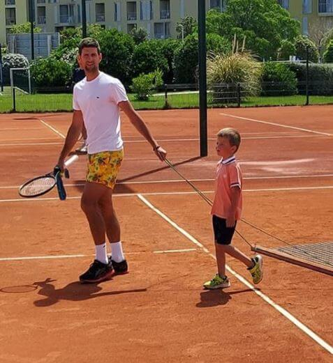Stefan Djokovic with his father, Novak Djokovic.