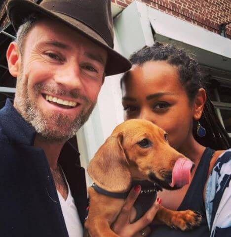 Melanie Liburd with her husband, Ben Taylor, and pet Winston.