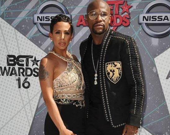 Devion Cromwell parents, Melissa Brim and Floyd Mayweather are posing in the BET awards.
