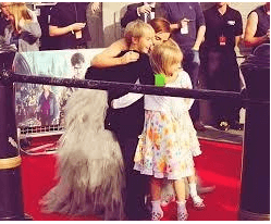 Emma Watson with her siblings on a red carpet