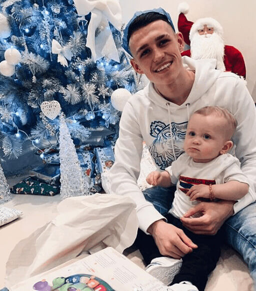 Phil Foden With Son Twining In White