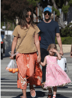 Dulcie Dornan with her mother, Amelia Warner, and father, James Dornan