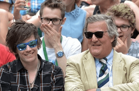 Elliott Spencer with his partner Stephen Fry chilling