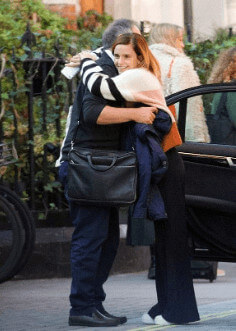 Chris is hugging his daughter Emma after lunch