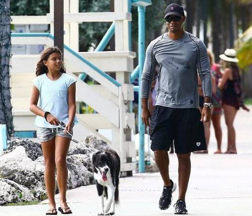 Sam Alexis Woods with her father, Tiger Woods