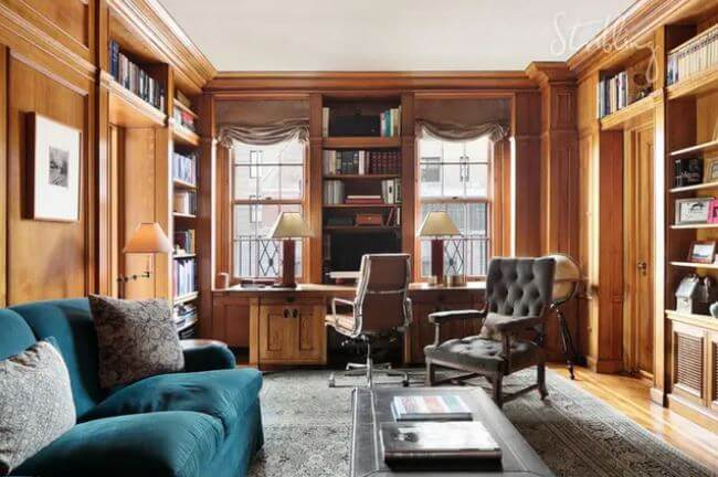 The wood-paneled library