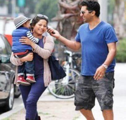 Cliff Curtis with his wife and kid.