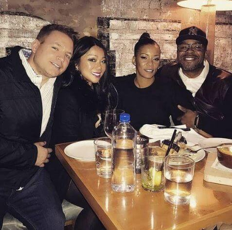 Tamika Smith with her husband and friends.