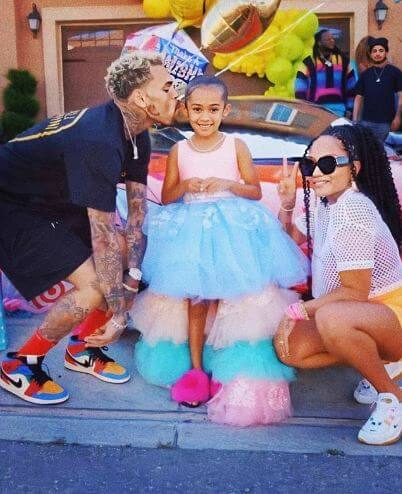 Royalty Brown with her parents on her 6th birthday party.