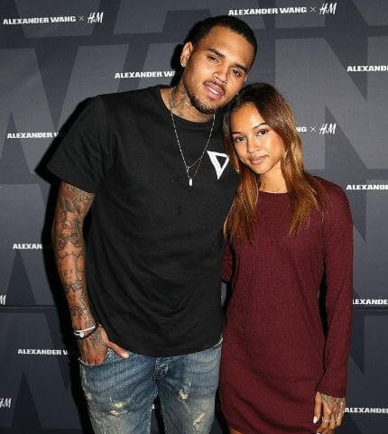 Royalty Brown's father, Chris Brown with his then-lover Karrueche Tran.
