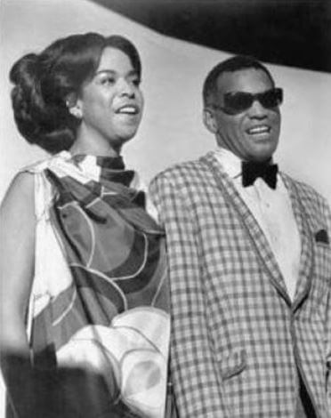 Della Beatrice Howard Robinson with Ray Charles.
