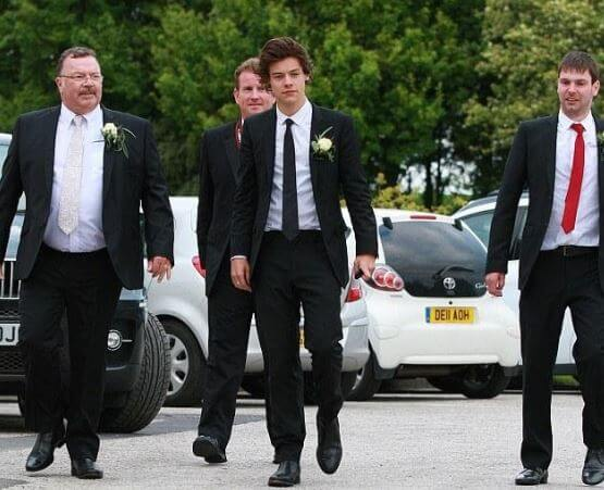 Amy Twist's father, Robin, with his son Mike Twist and Harry Styles.