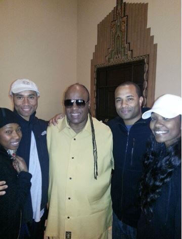 Takiyah Muhammad with her siblings and Stevie Wonder.