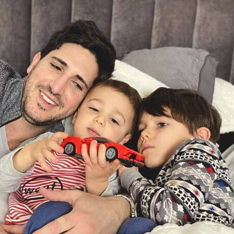 Andrea DeVos's husband, Michael Abraham, with their sons.