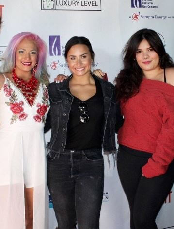 Amber Lovato's three siblings.