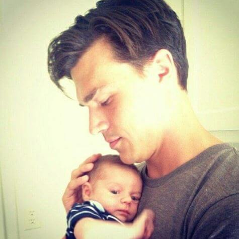 Finn Wittrock with a baby.