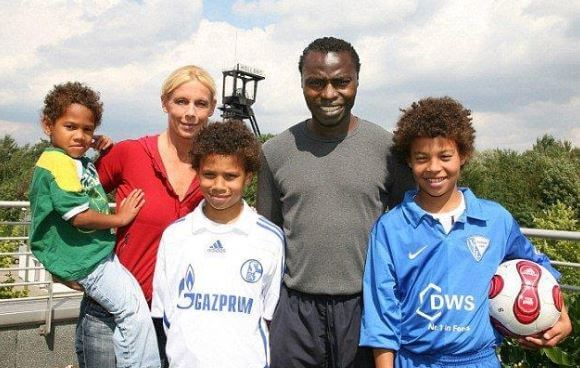 Souleymane Sane with his wife and children.