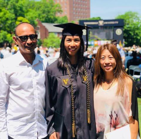 Astra Sharma with her parents on her graduation day.