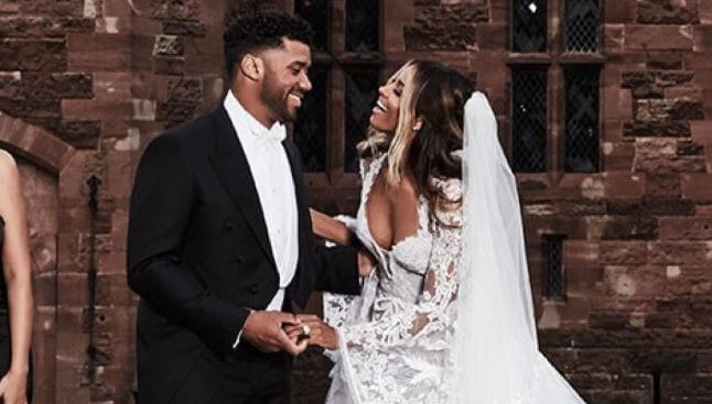 Future Zahir Wilburn with his mother, Ciara and Russell Wilson on their wedding.
