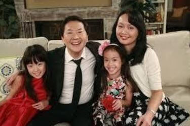 Tran Jeong with her spouse and twin daughters.