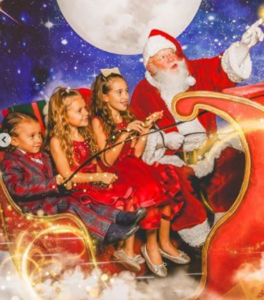 Her children with Santa Claus on Christmas Day