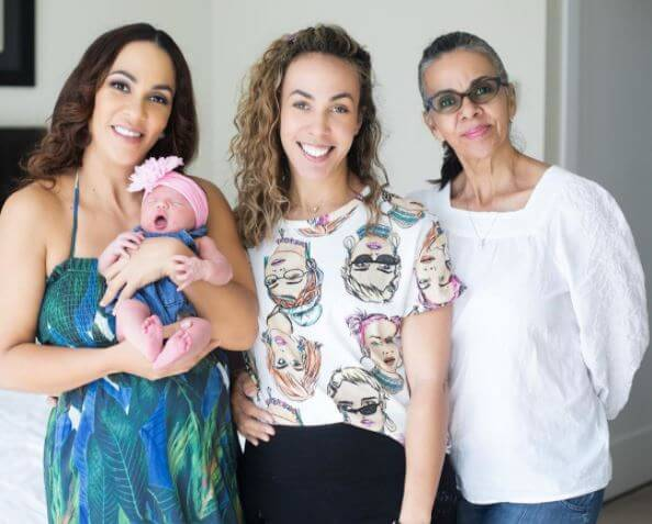 Jodi Stewart and her newborn baby, along with her mother and sister.