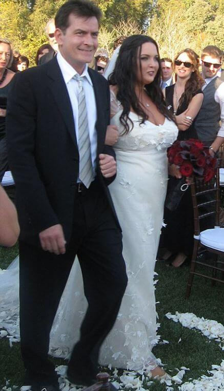 Cassandra Jade Estevez walks with her father, Charlie Sheen, down the aisle.