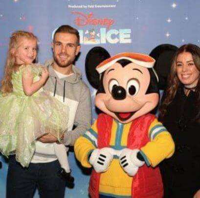 Rebecca Burnett with her husband, Jordan Henderson, and daughter.