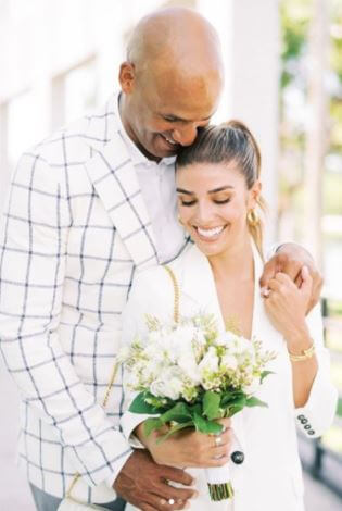 Joy Taylor's brother Jason Taylor and sister in law Monica Velasco on their wedding day.