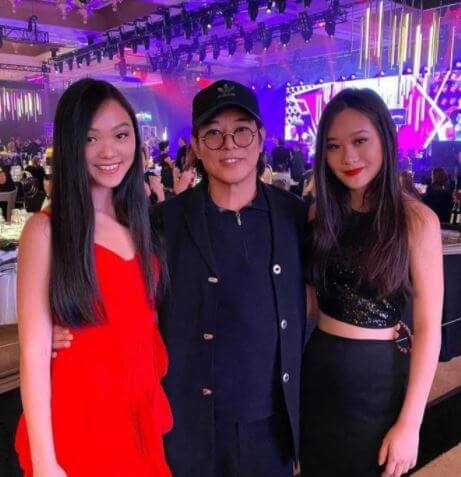 Nina Li Chi daughters Jane in a red dress and Jade in Black and her husband Jet Li.