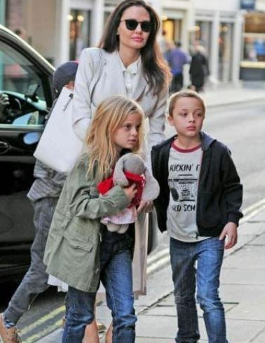 Vivienne Jolie-Pitt with her mother Angelina Jolie and brother Knox Leon.